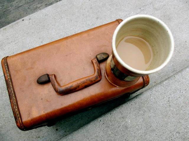 coffee mug on suitcase