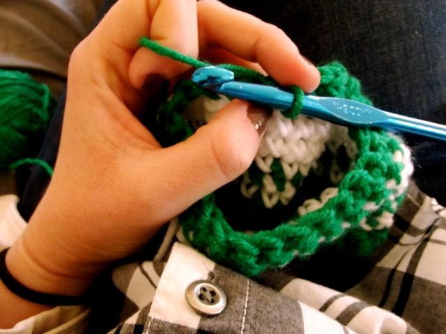 holding yarn and needle