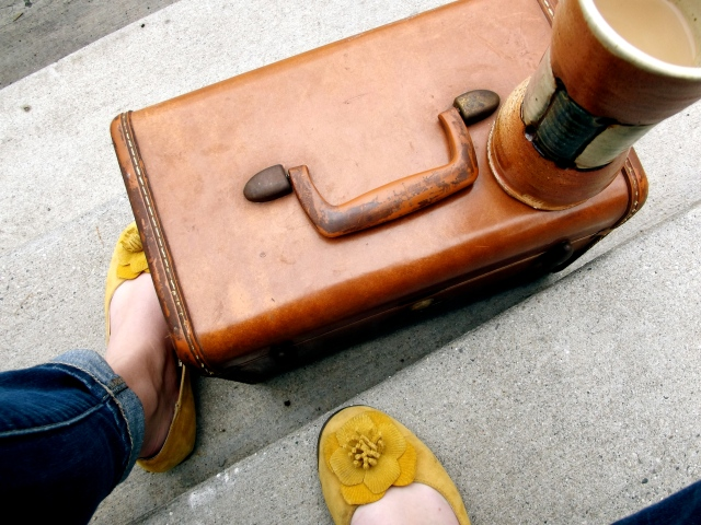 Suitcase and yellow shoes