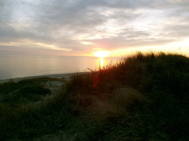 dunes with sunset in ludington