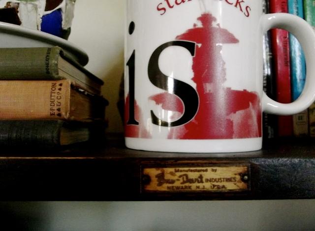 coffee on bookshelf