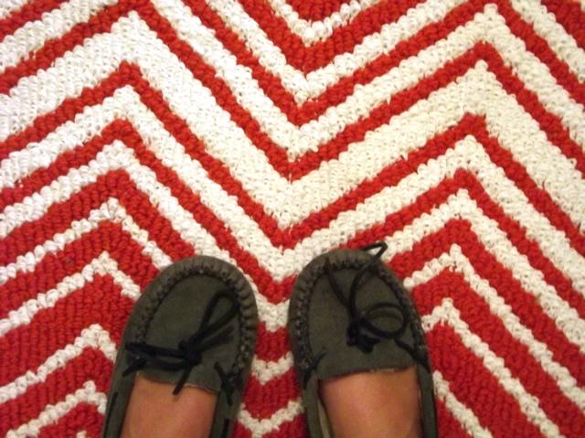slippers on orange rug